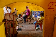 Cyclist riding through the Clock Tower Gate, amin entrance to the old city in Cartegana Colombia