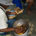 Man selling fried fish from a pot on the beach Cartagena Colombia