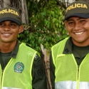 Two Colombian police smiling for the camera, head and shoulders