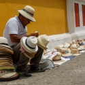 A man sitting amongst his hats for sale on the streets of Cartagena, Colombia