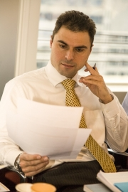 Businessman perusing document