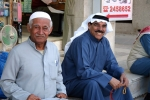 Smiling Middle Eastern gentlemen dressed in traditional clothing Kuwait