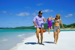 Family playing on Whitehaven Beach by Hill Inlet