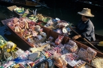 Lady selling goods at Damnoen Saduak Floating market Ratchaburi province Thailand Far East Asia