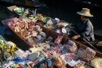 Lady selling goods at Damnoen Saduak Floating market Ratchaburi province Thailand Far East Asia
